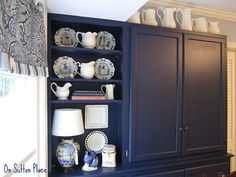 Cabinets are Naval (Sherwin Williams); wall is Windy Blue (SW) - too blue overall IMO, but I like the cab.: