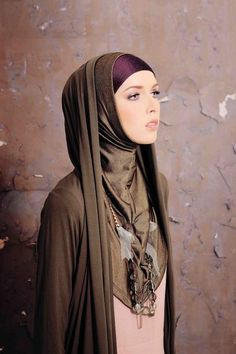 Hooded cardigan giving look of chador.