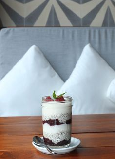 Very Berry Chia Parfait- Soaked overnight in creamy vanilla coconut milk, chia seeds are layered with our homemade probiotic coconut yoghurt, and a chia berry compote, and topped with delicious fresh berries.