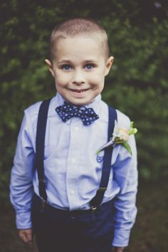 blue eyed ring bearer with bow tie and suspenders #ringbearer #bowtie #weddingchicks http://www.weddingchicks.com/2014/02/17/enchanting-rainy-day-wedding/