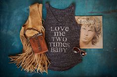 When it comes to lovin', sometimes once just isn't enough. No one can ignore Jim Morrison's rock star advice in this ultra soft and flowy tank top with an eye-catching distressed lyric design. The thi