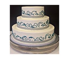 3-Tier Classic Wedding Cake (buttercream) with teal scrolling pattern and trimmed in grey ribbon.