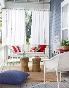 blue porch... Curtains and rug with pretty indoor accents