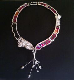 NECKLACE inspired in tradition and culture by connecting the past and the present, with a ludic viewpoint, it is possible to construct an innovative design without breaking apart with our past and expressing this heritage through contemporary jewelry