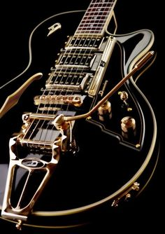 Black and gold electric guitar