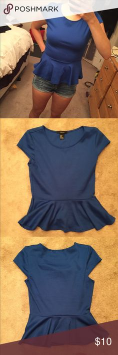 Forever 21 Medium Peplum Navy Blue Top Forever 21 Medium Navy Blue short sleeve peplum top. Beautiful color and fit. No signs of wear. Forever 21 Tops Blouses