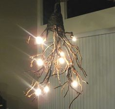 Crafty Butt: Craft Hack: DIY Rustic Chandelier I am pinning this one for my sister, Tisha.  She has wonderful lighting all through her house...this would work in lots of places.