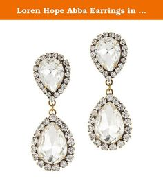 "Loren Hope Abba Earrings in Crystal. From Loren Hope the Abba earrings have a classic silhouette and stunning design. They are perfect for work or play and can take you from daytime to night. Two teardrop clear crystals are surrounded by hand-set clear glass stones for added sparkle and shine. The clear crystals are set in an antiqued brass finish for a vintage inspired look. These earrings measure 2"" in length and 3/4"" in width and have surgical steel posts. They are signed on reverse…"