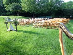 Wedding ceremony harpist at Royal Melbourne Country Club, Long Grove, Illinois    Rustic wildflower altar arrangements, purple & green    http://www.theclassicharpist.com