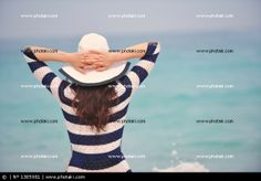 http://www.photaki.com/picture-happy-beautiful-woman-enjoying-summer-vacation_1385981.htm
