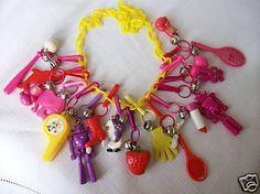 those 1980s charm bracelets/necklaces.  my mom kept mine and i just got it back!  i love it!