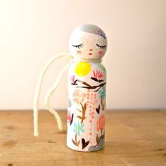 This maker features primarily floral patterns on her peg dolls