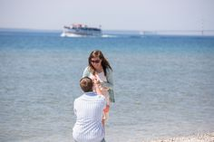 Surprise Engagement Mackinac Island Photo Windermere Point Proposal Northern Michigan destination location lake huron Mackinac Bridge view lighthouse with Paul Retherford Photography #surpriseengagement #mackinacengagement #surpriseproposal #shesaidyes #engaged #michiganengagement #puremichigan #wedding #proposalidea #engagementidea #engagementplanning #secret #cool #fun #mackinaw