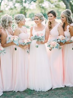 Springy pink bridesmaid gowns: http://www.stylemepretty.com/texas-weddings/2016/04/14/a-gorgeous-blush-texas-wedding-on-a-tight-budget/ | Photography: Tracy Enoch - http://www.tracyenoch.com/