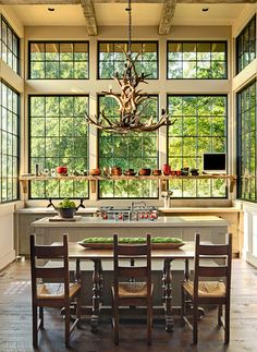 Of course the wood floor and unfinished beams make for a rustic kitchen, but readers really love the bright, open space flooded with light thanks to the custom windows. A floating wood shelf and an antler chandelier bring it all home.