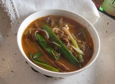 Yukgaejang (Spicy Beef Stew) Recipe for a classic spicy Korean stew made of thin strips of beef and a variety of vegetables.