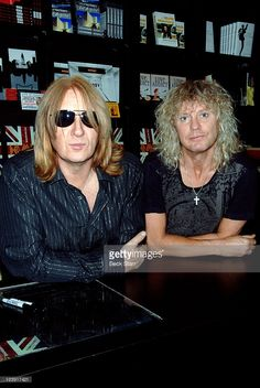 Def Leppard's Joe Elliott and Rick Savage sign copies of 'Def Leppard: The  Definitive