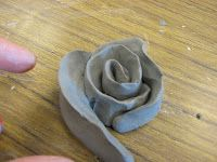 cool clay flower project on a grade MS art teacher blog