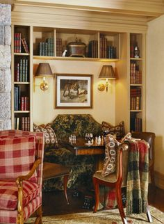 Library with cozy games/reading table and sconces - Cindy Rinfret, Rinfret, Ltd.
