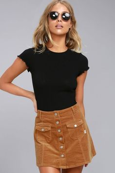 We can't imagine anything more lovely than you in the Rhythm Pennylane Tan Corduroy Mini Skirt beneath the blue suburban skies! Classic corduroy fabric begins at a banded waist with belt loop accents, and a full-length silver snap-button placket. Patch pockets atop the vertical seaming add a cute detail to this already darling A-line number. Small logo tag at front pocket.