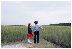 Siblings holding hands in front of the marsh. Fall family photos at The Landings in Savannah Georgia. Downtown Savannah Georgia family photos photographed by Kristen M. Brown of Samba to the Sea Photography. #familyphotos #savannah #savannahga