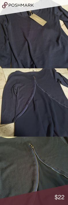 Metric New York top New attacks. Metric New York 3/4 sleeve top. Gorgeous zipper back. Minor snags other than that perfect condition no holes or stains. 7% viscose 30% nylon. Metric New york Tops