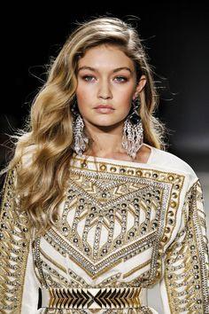 Gigi Hadid modeling for BALMAIN x H&M Fall Winter 2015/2016