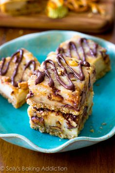 Pretzel Crusted Peanut Butter Cheesecake Bars. Salty, crunchy crust with a decadent and creamy peanut butter cheesecake filling.  Topped with a decadent chocolate drizzle! sallysbakingaddiction.com