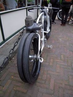 Custom bicycles. Not a motorcycle, but dig the rear wheel setup. Maybe some inspiration there!