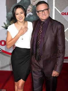 Inspiring: The 25-year-old actress, pictured with her dad in 2009, went on to say that 'reading of others who have dealt with this loss and gone on to live happy, full lives is helpful'