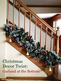 Instead of going the usual route and hanging greens on the banister, this blogger rested the garland on top of the steps. See more at The Nomadic Decorator » - HouseBeautiful.com