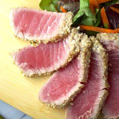 Sesame crusted ahi tuna with soy ginger lime sauce is a healthy and very simple dish to make! Pickled cucumbers add a sweet and tangy crunch with each bite. #video #ahituna #pokebowls #poke