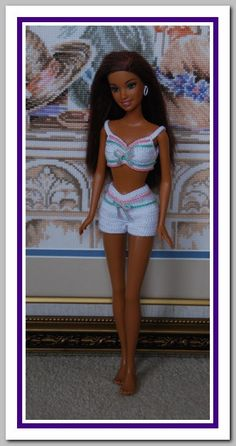 This outfit is made from White Crochet cotton # 10.  It fits Barbie belly button.      Note: Doll, necklace, earrings, furniture and shoes are not included.