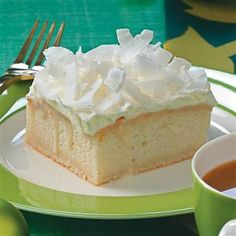 "Coconut Cream Yummy Cake Recipe -""I found this recipe as a kid in one of my mother's cookbooks. I didn't make it until I was older and now it is requested every Christmas. Sometimes I tint the coconut red and green for the holiday."" – Angela Renae Fox, Gober, Texas"