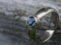 recycled 14ct white gold and teal FAIRTRADE sapphire anniversary ring commission Glasswing Jewellery