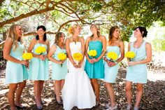 Maid of Honor in a darker color.. I've always loved this idea.    I really like the blue and yellow.....i'd do sunflowers for the bride and yellow roses/daisies for the girls