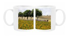 Photo Mug featuring The pack rides past a field of sunflowers during the 199 km…