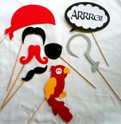 Pirate Photo Props  - Photo booth props - 11 Pieces - Wedding props- birthday party photo props - mustaches on a stick  - props on a stick. $15.00, via Etsy.