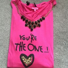 Betsey Johnson top You're the one with a heart. Has a bow detail on the sleeve. This is the perfect length to wear with leggings cause it covers the booty! Could also be used as a sleep shirt I HAVE TWO OF THESE IN STOCK Betsey Johnson Tops Tees - Short Sleeve