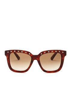 Square studs adorn the top of chic sunglasses in a squared-off silhouette, adding a touch of edge to an already-fashionable look.
