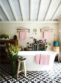 Relaxed bathroom - eclectic mix of textures and colours. Black and white tiles with a little pink hit. Image Via: Bohemian Design