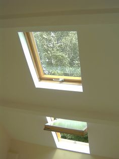 Enjoy a green view with FAKRO roof windows. Doesn't the room look brighter? #roofwindows #centrepivot #homedesigns #housedesigns #sunlight #windows #glass