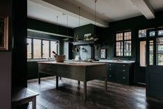 [Room] Restored farmhouse kitchen maintained the leaded windows, flagstone floors and oak-paneled walls while adding updated cabinetry, lighting and fixtures in this home in Shropsire, England. Plain English Kitchen, English Kitchens, Dark Green Kitchen, New Kitchen, Kitchen Ideas, Kitchen Inspiration, Kitchen Redo, Kitchen Styling, Kitchen Remodel
