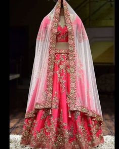 Crimson Pink Zardosi Embroidered Raw Silk Bridal – Stylizone A beautiful blush pink gown with a heavily embellished bodice in pearls, beads, and sequins on the front and back. The gown has an irregular pearl spray, highlighting the outfit. Bridal Lehenga Online, Designer Bridal Lehenga, Indian Bridal Lehenga, Lehenga Choli Online, Wedding Lehnga, Wedding Wear, Ghagra Choli, Desi Wedding, Wedding Outfits