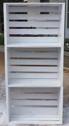 Made it myself! I bought wooden crates from Menards spray painted them white and stacked them on top of each other. I'm using it for a makeup, plant shelf and I made other ones from a stack of 2 for night stands! Look wonderful in my space!