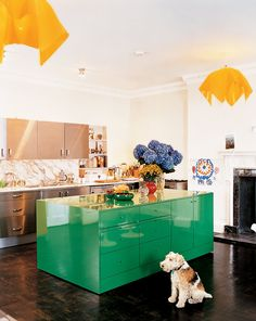 Built by the Earl of Mansfield at the end of the 18th century, this London West End townhouse owned by Serena Rees and Joseph Corré of Agent Provocateur has all of the beautiful details that a historic home should. In the kitchen, rather than distracting from the building's history, the stark contrast of the stainless steel cabinetry and lacquered Kelly green island help to call attention to the period details in the room, such as the dentil molding and carved fireplace mantel.
