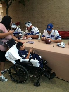 Travis Frederick and Tony Romo signing for a guest at Texas Scottish Rite Hospital for Children #DallasCowboys