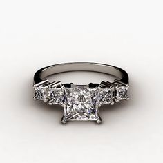 5 Stone Princess Cut Engagement Ring. Elegance defined, this diamond engagement ring showcases four graduated, princess cut diamonds set in enduring gold or platinum. Each side diamond is ideally matched in clarity, color and cut to complement your choice of center diamond. Price: $2,277 (Sale Price: $2,049) http://nataliediamonds.com/five-stone-princess-cut-diamond-engagement-anniversary-ring-078w.html #NatalieDiamonds #engagementring #diamondstone