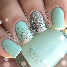 Sea foam green nails with silver confetti glitter and accent silver glitter nail.