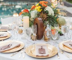 For a destination wedding, use inscribed luggage tags for place cards as a welcoming keepsake for each wedding guest!